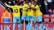 Crystal Palace's Marouane Chamakh (second from left) is congratulated by team mates after scoring the third goal for his side during the FA Cup Fourth Round match at St Mary's