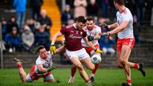 Damien Comer of Galway is tackled by Liam Rafferty, left, and Ronan McNamee of Tyrone resulting in a penalty