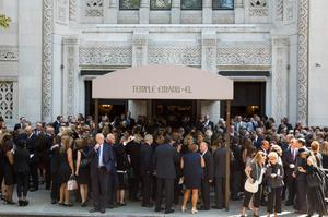 Mourners depart the funeral of comedian Joan Rivers at Temple Emanu-El in New York September 7, 2014. REUTERS/Lucas Jackson