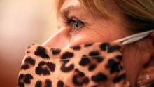 Cathy Slusher of Harrisonburg, Virginia wears a animal print face mask while meeting with students, teachers and administrators about how to safely re-open schools during the novel coronavirus pandemic. (Photo by Chip Somodevilla/Getty Images)