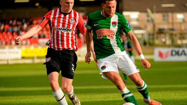 26 June 2015; Billy Dennehy, Cork City, in action against Ronan Curtis. SSE Airtricity League Premier Division, Derry City v Cork City, Brandywell, Derry. Picture credit: Oliver McVeigh / SPORTSFILE