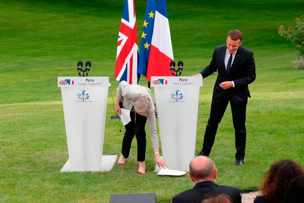 British Prime Minister Theresa May loses her grip on her notes