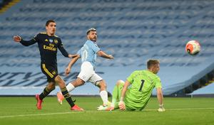 Manchester City's Sergio Aguero shoots at goal. Photo: Peter Powell/Pool via Reuters