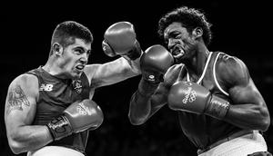 3rd Sports Action Ireland's Joe Ward lands a left hook on Ecuador's Carlos Andres Mina during their Light-Heavyweight bout during the 2016 Summer Olympic Games in Rio de Janeiro  Brazil. Ramsey Cardy Sportsfile