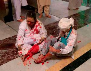 Wounded pilgrims sit on the floor after a crane collapse that killed dozens inside the Grand Mosque in Mecca, Saudi Arabia, Friday, Sept. 11, 2015. The accident happened as pilgrims from around the world converged on the city, Islam's holiest site, for the annual Hajj pilgrimage, which takes place this month. (AP Photo)