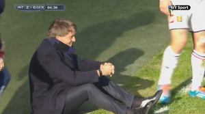 Roberto Mancini gathers himself after he was floored by a clearance