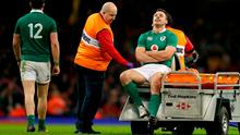 Ireland's Tommy Bowe leaves the field injured during the RBS Six Nations at the Principality Stadium, Cardiff. Photo: David Davies/PA Wire
