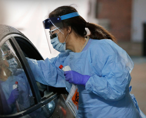 A nurse at a drive-up testing faciility in the US. Picture: AP