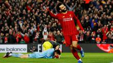 Liverpool's Mohamed Salah celebrates scoring their fourth goal as Southampton's Alex McCarthy looks dejected. REUTERS/Phil Noble