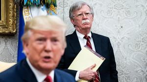 John Bolton, the national security adviser at the time, listens to President Donald Trump during an Oval Office meeting in July 2019. Photo credit: Washington Post photo by Jabin Botsford
