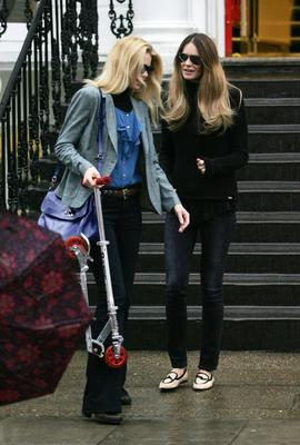 Elle Macpherson and Claudia Schiffer on the school run in Notting Hill on February 10, 2011 in London, England.