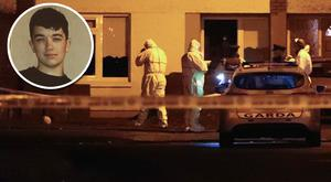 Gardaí at the scene of the fatal stabbing in Kilclare Crescent, Jobstown, last night. Photo: Collins. Inset, victim Reece Cullen