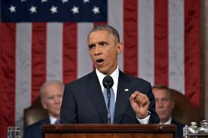 U.S. President Barack Obama (C) delivers his State of the Union address to a joint session of Congress on Capitol Hill in Washington