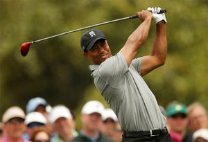Tiger Woods hits his tee shot on the 10th hole during first round of the US Masters