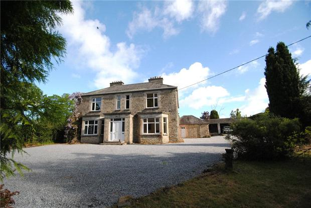 A TALE OF TWO WORLDS: Old Castle House, in Dungar, Roscrea, Co Tipperary, has an asking price of €395,000 and comes with six bedrooms, three bathrooms and 4.9 acres.