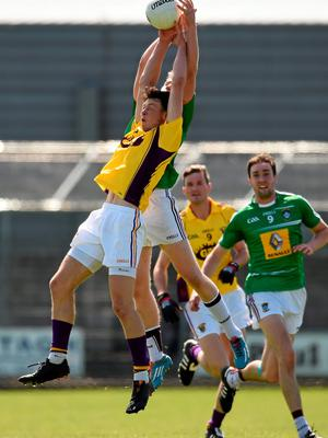 14 June 2015; Eoghan Nolan, Wexford, in action against Paddy Holloway, Westmeath. Leinster GAA Football Senior Championship Quarter-Final, Westmeath v Wexford. Cusack Park, Mullingar, Co. Westmeath. Picture credit: Paul Mohan / SPORTSFILE