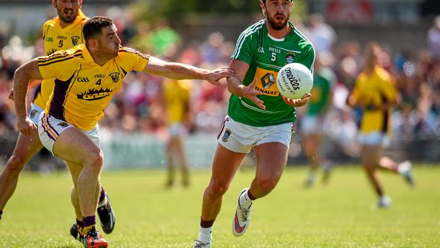 14 June 2015; Paul Sharry, Westmeath, in action against Joey Wadding, Wexford. Leinster GAA Football Senior Championship Quarter-Final, Westmeath v Wexford. Cusack Park, Mullingar, Co. Westmeath. Picture credit: Paul Mohan / SPORTSFILE