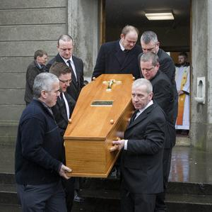 The remains of founding member of the Chieftains Sean Potts leaving the Church of Our Lady Help of Christians, Navan Road after his funeral mass. Pic: Mark Condren