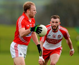 Cork's Michael Shields in action against Terence O'Brien of Derry