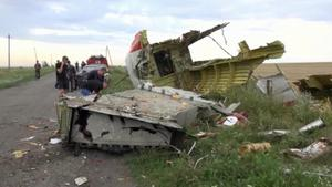 In this image taken from video, Thursday July 17, 2014,  showing part of the wreckage of a passenger plane carrying 295 people after it was shot down Thursday as it flew over Ukraine, near the village of Hrabove, in eastern Ukraine. AP Photo / Channel 1