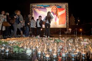People put candles as they pay homage to Olympic gold medalist swimmer Camille Muffat, in Nice southeastern France (AP Photo/Lionel Cironneau)