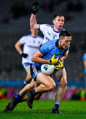 Brian Fenton of Dublin is tackled by Karl O'Connell of Monaghan. Photo: Ray McManus/Sportsfile