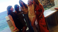A pregnant Leigh relaxes with friends at Amanthe restaurant, Ibiza