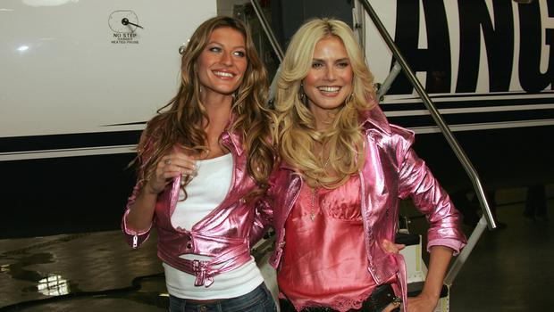 Victoria's Secret models Gisele Bundchen and Heidi Klum kick off the Angels Across America tour November 8, 2004 in New York City.  (Photo by Evan Agostini/Getty Images)