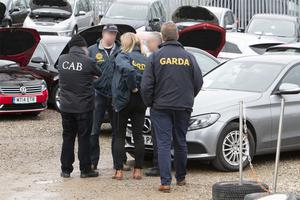 Gardai and CAB officers at a raided car business in Limerick