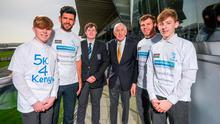 Blackrock College Transition Year students (l-r) Joe Byron, Conor O'Neill and Alex Carroll, with Dublin footballer Cian O'Sullivan, left, Dr Ronnie Delany, 1956 Olympic 1,500m Champion, and Ireland and Leinster flanker Jordi Murphy, right, in attendance at the launch of the 5K4KENYA Open Run at Leopardstown Racecourse in Dublin. Photo: STEPHEN MCCARTHY/SPORTSFILE