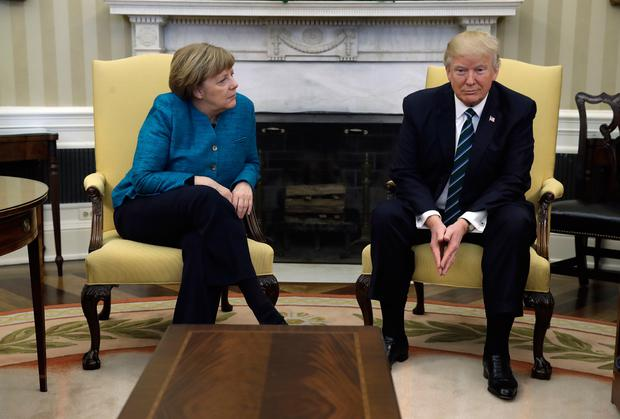 President Donald Trump meets with German Chancellor Angela Merkel in the Oval Office of the White House in Washington, Friday, March 17, 2017. Photo: AP Photo/Evan Vucci
