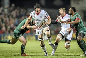 Ulster's Franco Van Der Merwe charges through a tackle from Leicester's Marcos Ayerza