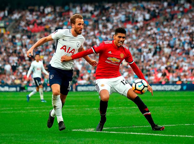 Tottenham Hotspur's Harry Kane and Manchester United's Chris Smalling. Photo: Nick Potts/PA Wire