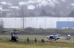 Police and army forces take positions in Dammartin-en-Goele, northeast Paris, as part of an operation to seize two heavily armed suspects. (AP Photo/Michel Spingler)