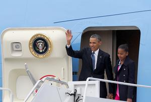 U.S. President Barack Obama waves as he leaves Air Force One with his daughter Sasha, after landing at Belfast International Airport, in Northern Ireland June 17, 2013.