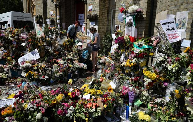 Floral tributes for the victims of the Grenfell Tower fire are left outside the Notting Hill Methodist Church, in London, Britain June 20, 2017. REUTERS/Marko Djurica