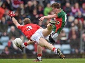 Cork full-back Michael Shields dives to make a block on a shot from Mayo's Danny Kirby during yesterday's clash at Pairc Ui Rinn
