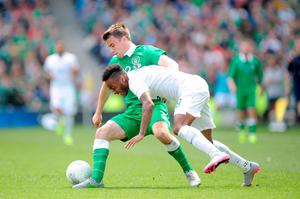 England's Raheem Sterling (right) and Republic of Ireland's Seamus Coleman battle for the ball during the international friendly at The Aviva Stadium, Dublin, Ireland