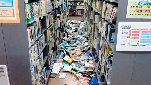 Books are scattered on the floor at a library in Iwaki, Fukushima prefecture Tuesday, Nov. 22, 2016 after a strong earthquake (Kyodo News via AP)
