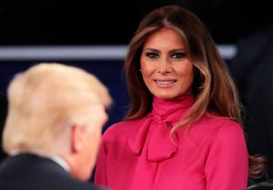 Melania Trump (R) greets her husband Republican presidential nominee Donald Trump after the town hall debate at Washington University on October 9, 2016 in St Louis, Missouri. This is the second of three presidential debates scheduled prior to the November 8th election.  (Photo by Scott Olson/Getty Images)