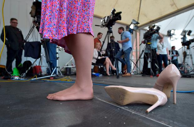 DUBLIN, IRELAND - MAY 23:  Drag queen artist and Yes campaign activist, Panti Bliss is interviewed bare foot by news crews as thousands gather in Dublin Castle square awaiting the referendum vote outcome on May 23, 2015 in Dublin, Ireland.  (Photo by Charles McQuillan/Getty Images)