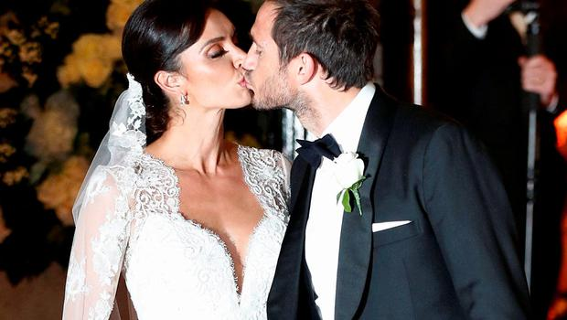 British TV personality Christine Bleakley and former Chelsea and England soccer player, Frank Lampard kiss as they leave church after they married in London, Britain, December 20, 2015