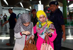 Family members of those onboard the missing Malaysia Airlines flight walk into the waiting area at Kuala Lumpur International Airport in Sepang March 8, 2014.      REUTERS/Samsul Said