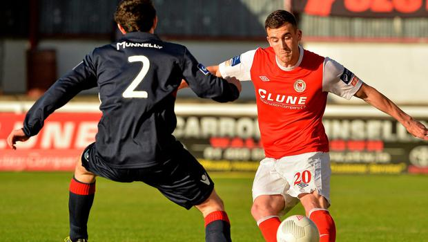 Aaron Greece is closed down by Longford Town's Jamie Mulhall