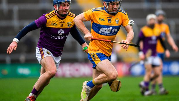 Shane O'Donnell of Clare in action against Kevin Foley of Wexford during the Allianz Hurling League Division 1 Group B Round 2 match  at Chadwicks Wexford Park