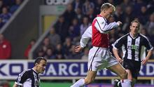 Having turned Newcastle defender Nikos Dabizas inside out, Arsenal's Dennis Bergkamp sweeps the ball to the net as Andy O'Brien (right) can only look on at St James' Park back in March 2002. Photo: REUTERS/Ian Hodgson