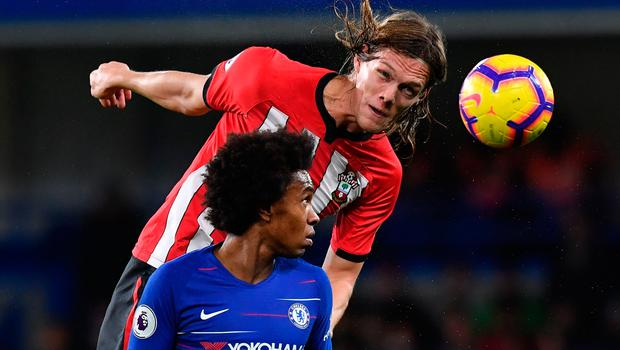 Southampton's Danish Jannik Vestergaard and Chelsea's Willian rise for the ball. Photo: Getty Images
