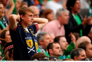 13 June 2015; A Scotland fan reacts to the Republic of Ireland goal during he first half. UEFA EURO 2016 Championship Qualifier, Group D, Republic of Ireland v Scotland, Aviva Stadium, Lansdowne Road, Dublin.