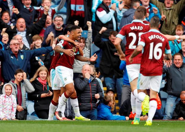 Burnley's Andre Gray celebrates scoring their second goal with teammates