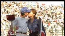 Damon Hill (left) and wife Georgie kiss to celebrate his success during the Japanese grand prix at Suzuka, Japan. Mandatory Credit: Pascal Rondeau/Allsport